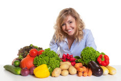 Blond woman with fresh vegetables looking at camera Stock Photo
