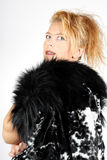 Blond woman with fur Royalty Free Stock Photography