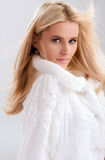 Blond woman in fur Royalty Free Stock Image