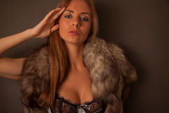 Blond woman in fur neckpiece and lace lingerie Royalty Free Stock Images