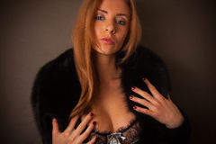 Blond woman in fur neckpiece and lace lingerie Stock Images