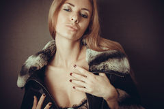 Blond woman in fur neckpiece and lace lingerie Stock Photography