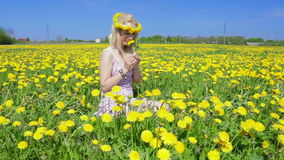 Blond woman is gathering flowers. stock video footage