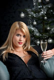 Blond woman with glass of champagne on Christmas Royalty Free Stock Photo