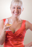 Blond woman with a glass of wine. #1. Smiling blond woman with a glass of white wine. #1 royalty free stock photos