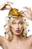 Blond woman with a golden bow Royalty Free Stock Images