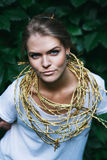 Blond woman with golden headband Royalty Free Stock Image