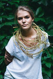 Blond woman with golden necklace Royalty Free Stock Image