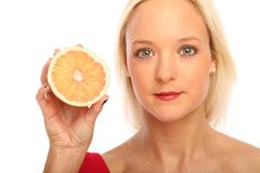 Blond woman with a grapefruit Stock Photo