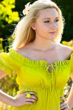 Blond woman in green dress outdoor Stock Images