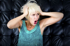 Blond woman in green dress is screaming Royalty Free Stock Photos