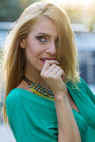 Blond woman in green dress Royalty Free Stock Photo