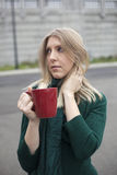 Blond Woman in Green Top Drinking Coffee Royalty Free Stock Photo