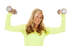 Blond woman green top fitness flex weights look Royalty Free Stock Photos