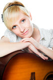 Blond woman with guitar on isolated white Royalty Free Stock Photos