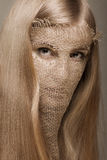 Blond woman with gunny mask Royalty Free Stock Photos