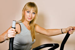 Blond woman  in gym Royalty Free Stock Images