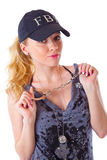 Blond woman with handcuffs Royalty Free Stock Photography