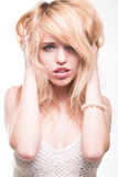 Blond Woman with Hands in Hair Stock Images