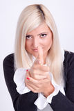 Blond woman hands making a sign with finger like shooting Stock Photo