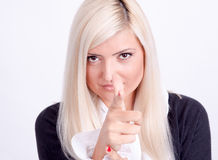 Blond woman hands making a sign with finger like shooting Stock Photography