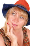 Blond woman with hat. A portrait image of a pretty blond woman in a dress wearing a summer Royalty Free Stock Photo