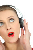 Blond woman with headphones Royalty Free Stock Photography