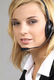 Blond woman with headset Royalty Free Stock Photo