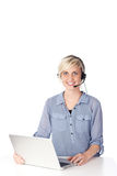 Blond Woman With Headset Looking At Camera Royalty Free Stock Images