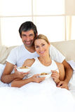 Blond woman and her boyfriend eating cerelals Stock Images