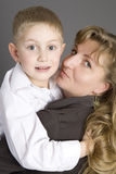 Blond woman with her son Stock Images