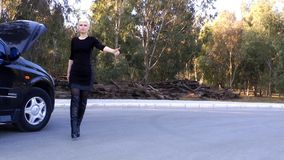 Blond Woman Hitchhiking stock video