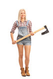 Blond woman holding an axe Royalty Free Stock Photo
