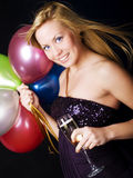 Blond woman holding ballons and champagn champagne Royalty Free Stock Images