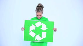 Blond woman holding a banner for the environment stock video footage