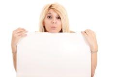 Blond woman holding billboard Stock Photos