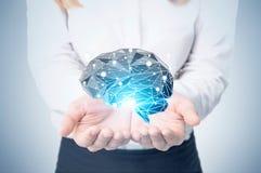 Blond woman holding a black brain hologram Stock Photo