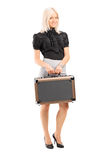 Blond woman holding a briefcase Stock Photography