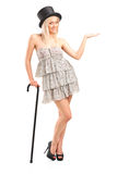 Blond woman holding cane and gesturing. Full length portrait of a blond woman holding cane and gesturing  on white background Stock Photography