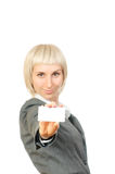 Blond woman holding a card Stock Images