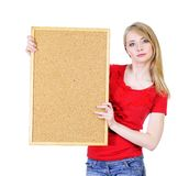 Blond woman holding a cork board. Pretty young blond woman holding a cork board isolated on white looking straight Royalty Free Stock Photos