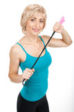 Blond woman holding jumping rope. Royalty Free Stock Photo