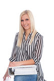 Blond Woman Holding Open Binder. Blond Woman Wearing Striped Shirt Holding Open Binder Stock Images