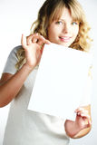 Blond woman holding a paper Stock Photography