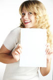 Blond woman holding a paper Royalty Free Stock Image