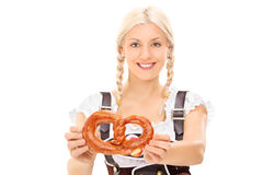 Blond woman holding a pretzel Royalty Free Stock Photography