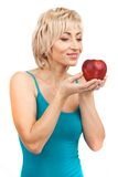 Blond woman holding red apple. Stock Photography
