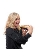 Blond woman holding a sandwich. Royalty Free Stock Image