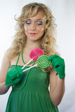 Blond woman holding two lollipops Royalty Free Stock Photo
