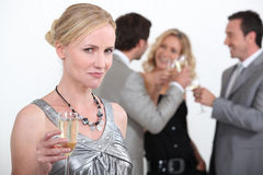 Blond woman holding up champagne Royalty Free Stock Photo